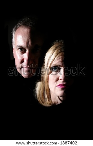 Husband and wife being exposed by coming into the light.
