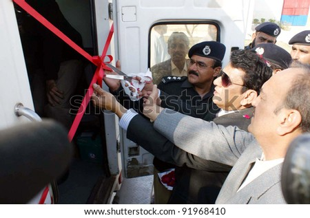 HYDERABAD, PAKISTAN, JAN 03: Sindh Fisheries Minister, Zahid Ali Bhurgari cuts ribbon to inaugurate NADRA Mobile Registration Van during ceremony held at Nara Jail in Hyderabad, January 03, 2012.