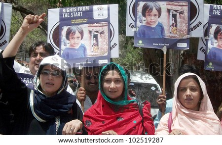 HYDERABAD, PAKISTAN - MAY 14: Supporters of Sindh Development Society hold posters chant slogans in favor of child education during awareness rally on Education for All on May 14, 2012 in Hyderabad.