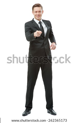 I choose you! Full length of confident young businessman pointing you and smiling. Isolated on white.