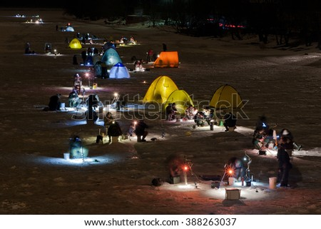 Northern swans spring stock photo 492276937 shutterstock for Ice fishing at night