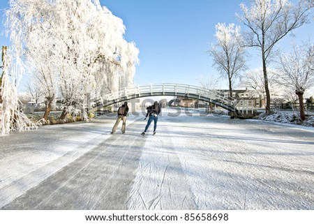 Ice skating in the countryside in winter in the Netherlands