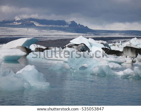 iceberg with black ashes, icelandic glacier