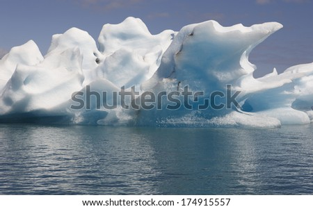Icebergs floating and glacier in the background on Jokulsarlon Iceland Southeast area