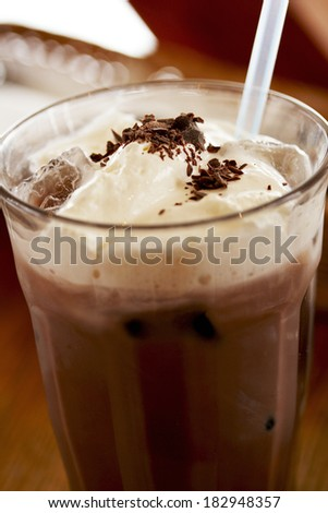 Iced chocolate with wiped cream and chips