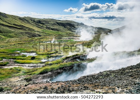 Icelandic landscape with steaming geysers