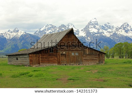 Iconic view of an old wooden barn in Grand Teton National Park, Wyoming, USA.