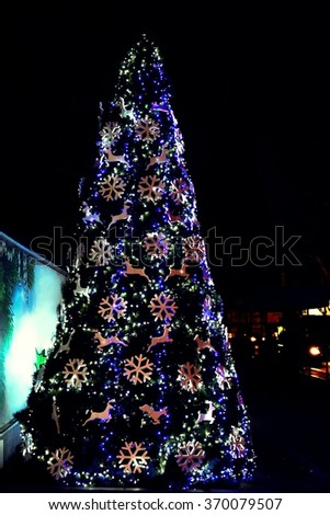 Illuminated Christmas tree in the city