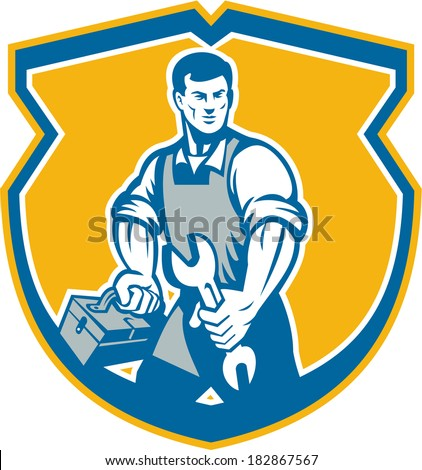 Illustration of a mechanic with spanner wrench carrying toolbox facing front set inside crest shield on isolated background done in retro style.