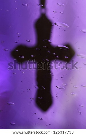 Image of a cross taken through purple glass