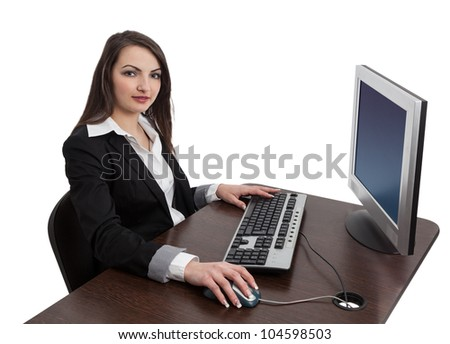 Image of a young brunette woman working on a computer while looking to the camera, isolated against a white background.