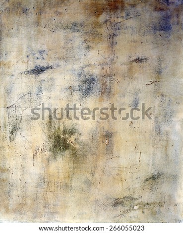 Image of an old, grungy piece of canvas with crevice and stain
