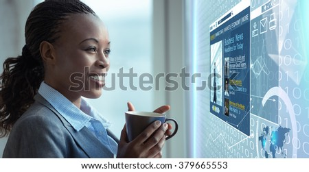 Image of businesswoman reading news on media screen