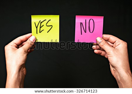 Image of colored stickers isolated on black background with the words yes and no. The concept of making the right choice, make the choice.
