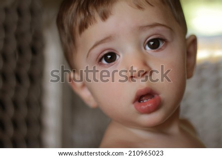 Image of cute baby boy, closeup portrait of adorable child's face, sweet toddler with huge eyes, healthy childhood,  perfect Caucasian infant, lovely kid, innocence concept