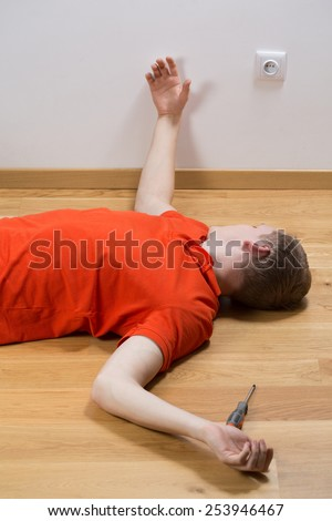 Image of electrocuted man lying on the floor