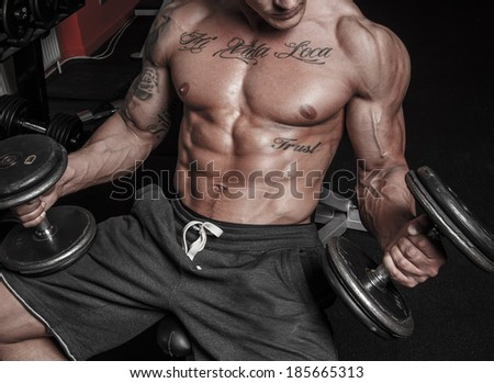 Image of fit man who is doing exercises