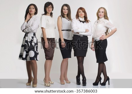 Image of five successful businesswomen looking at camera