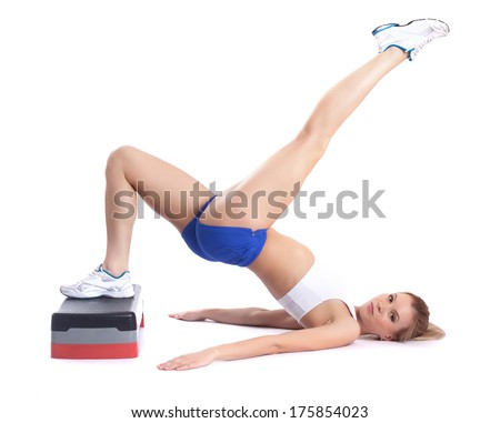 Image of flexible young girl exercising on stepper