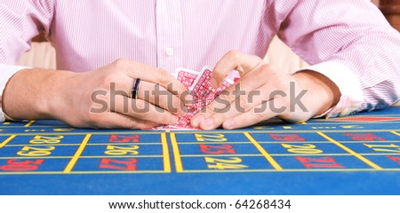 Image of gamblers  hands during game