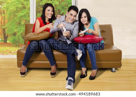 Portrait Young People Playing Games Living Stock Photo 495792079