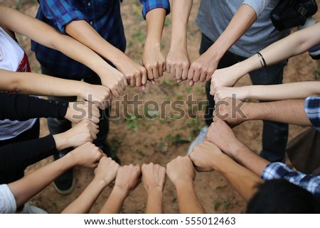 Image of hands in circle as symbol of their partnership and teamwork,we will do the best concept.