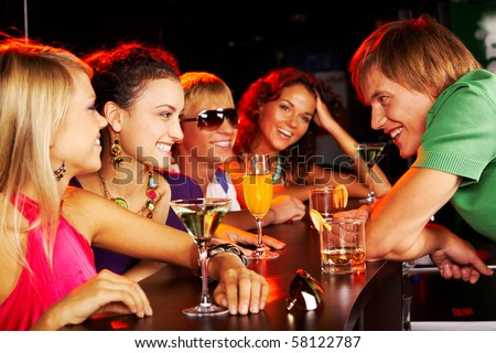 Image of happy teenagers chatting in the bar