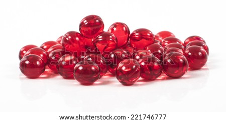 Image of red pills isolated close up