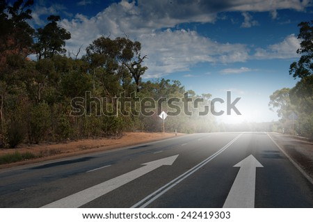 Image of road and arrow on asphalt pointing direction