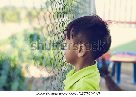 Image of sad boy,cage or prison with no freedom concept