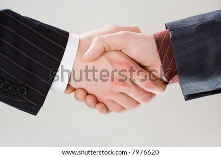 Image of shaking hands making an agreement on the white background