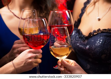 Image of women's hands with crystal glasses of wine