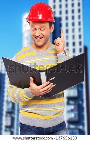 Image of worker who found something successful in papers