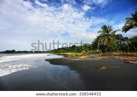 Beach on st kitts island black stock photo 470872310 for Black sand beaches costa rica