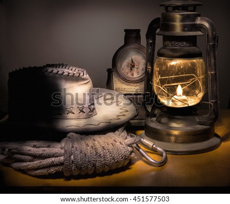 In the old barn on the table, cowboy hat, rope and kerosene lantern, and the old clock