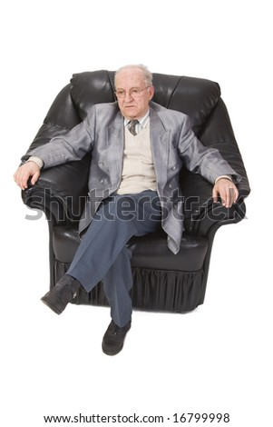 Inage of a senior man sitting in an armchair against a white background.