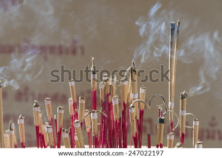 Incense sticks in ashes bucket