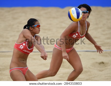 INCHEON-SEP 26 : Sakurako Fujii  (R) and Ayumi Kusano of Japan in action during women's beach volleyball 2014 Asian Games at Songdo Global on September 26, 2014 in Incheon, South Korea