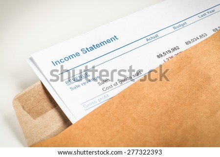 Income statement letter in brown envelope opening, business concept; document is mock-up