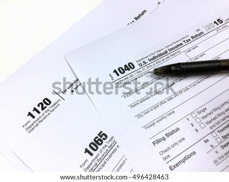 Income Tax Return Form for 2015 year with pen, close up