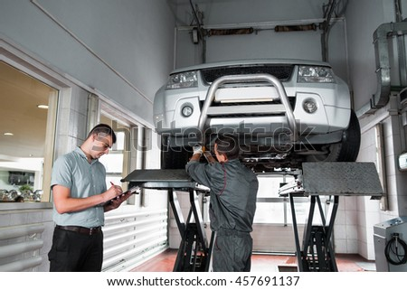 mechanic diagnosing car wheel screwdriver car stock photo 451058215 shutterstock. Black Bedroom Furniture Sets. Home Design Ideas