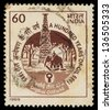 INDIA - CIRCA 1989: A stamp printed in India shows a hundred years of oil, circa 1989 - stock photo