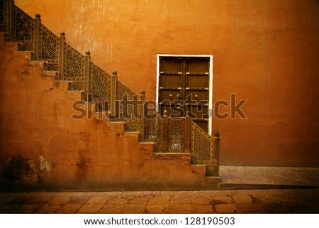 India, orange interior of a local house, stairs