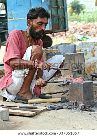 Indian blacksmith working on the streets. Pictured in Ahmedabad India, 25 October 2015