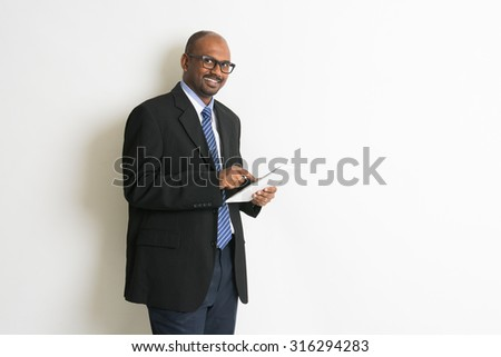 indian business man in tablet