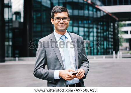 Indian business man with smartphone
