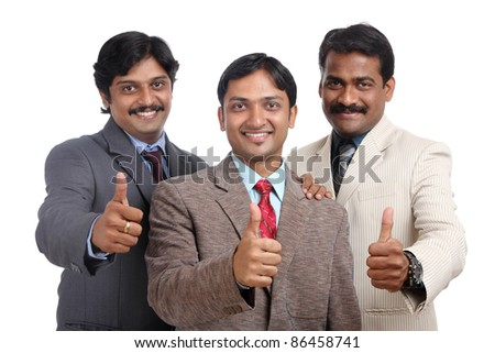 Indian business people posing to the camera