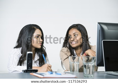 Indian business woman in office working together.