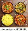 Indian chicken and vegetable curries with pilau rice. - stock photo