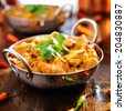 indian chicken curry in balti dish - stock photo